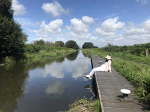 image of canal bank on a sunny day
